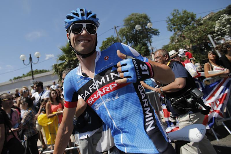 Ryder Hesjedal of Canada gives a thumbs up as he waits to take the start of the first stage of the 100th edition of the Tour de France cycling race over 213 kilometers (133 miles) with start in Porto Vecchio and finish in Bastia, Corsica island, France, Saturday June 29, 2013.(AP Photo/Christophe Ena)