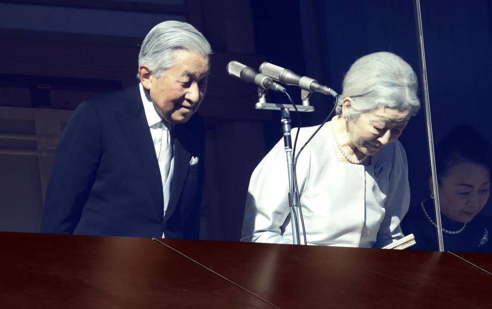 Japan's Emperor Akihito and Empress Michiko greet to well-wishers from the bullet-proofed balcony during his New Year's public appearance with his family members at Imperial Palace in Tokyo Wednesday, Jan. 2, 2019. (AP Photo/Eugene Hoshiko)