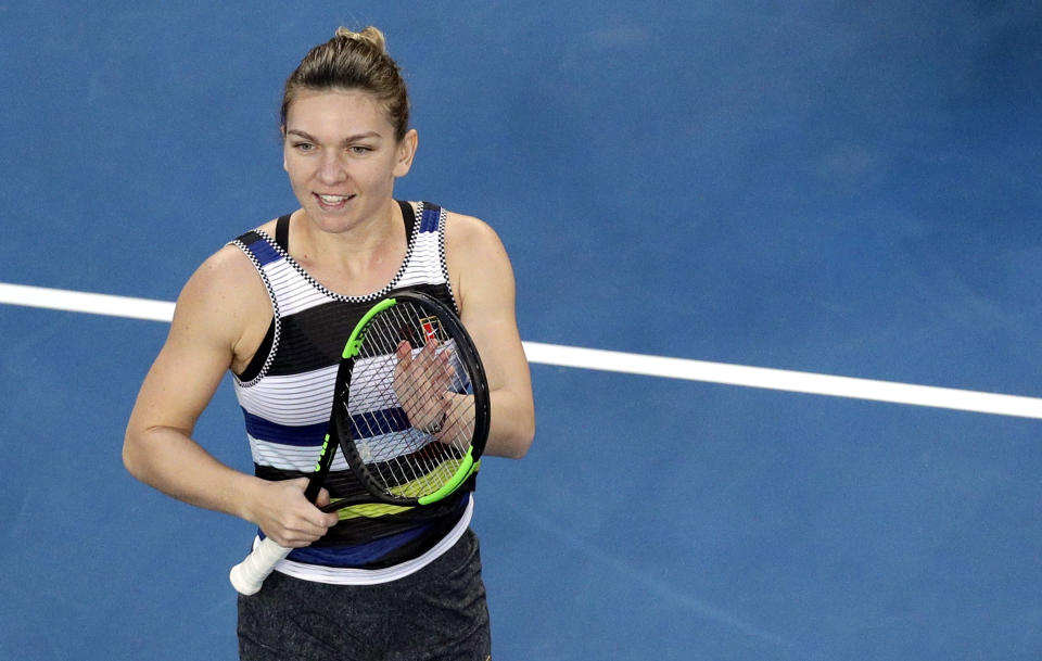 Romania's Simona Halep celebrates after defeating United States' Venus Williams during their third round match at the Australian Open tennis championships in Melbourne, Australia, Saturday, Jan. 19, 2019. (AP Photo/Kin Cheung)