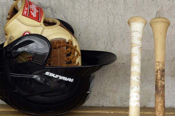Seattle Mariners baseball equipment in the dugout before the start of a spring training baseball game against the Milwaukee Brewers Monday, March 8, 2010, in Phoenix. The Brewers defeated the Mariners 6-2. (AP Photo/Ross D. Franklin)