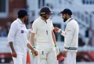 <p>Cricket - Second Test - England v India - Lord's Cricket Ground, London, Britain - August 16, 2021 India's Virat Kohli with England's Jos Buttler Action Images via Reuters/Paul Childs</p>