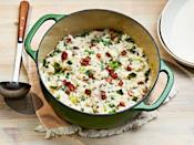 "<p><strong>Recipe: <a href=""https://www.southernliving.com/recipes/oven-baked-risotto-ham-leeks-peas"" rel=""nofollow noopener"" target=""_blank"" data-ylk=""slk:Oven-Baked Risotto with Ham, Leeks, and Peas"" class=""link rapid-noclick-resp"">Oven-Baked Risotto with Ham, Leeks, and Peas</a></strong></p> <p>Risotto gets a bad reputation for being fussy to make, but this truly one-dish dinner makes it easier than ever. Our readers found ways to tweak this recipe with what they had on hand, and one said ""it was a hit"" with her family.</p>"
