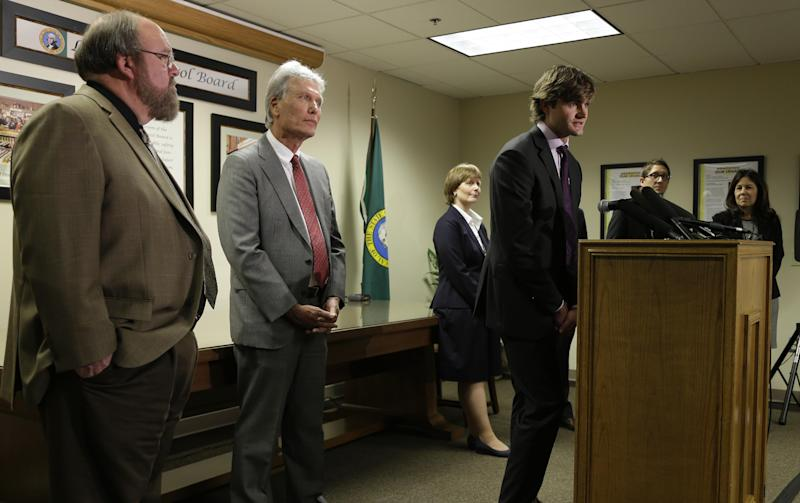 Steven Davenport, center, project manager for Botec Analysis Corp., takes questions from reporters Tuesday, March 19, 2013, as he is introduced in Olympia, Wash., along with other members of the team who are the tentative winners of the bidding process to be the official legal marijuana consultants for Washington State. Other team members are Michael Sautman, second from left, Lowry Heussler, third from left, and Beau Kilmer, second from right. Looking on at left is Randy Simmons, I-502 implementation project manager for the Washington State Liquor Control Board, and WLCB administrative director Pat Kohler, right. Botec will advise Washington state officials as they develop rules for the state's new industry in legal, taxed marijuana. (AP Photo/Ted S. Warren)