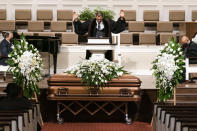 """Pastor Richard W. Wills, Sr. prays during the funeral services for Henry """"Hank"""" Aaron, longtime Atlanta Braves player and Hall of Famer, on Wednesday, Jan. 27, 2021 at Friendship Baptist Church in Atlanta. (Kevin D. Liles/Atlanta Braves via AP, Pool)"""