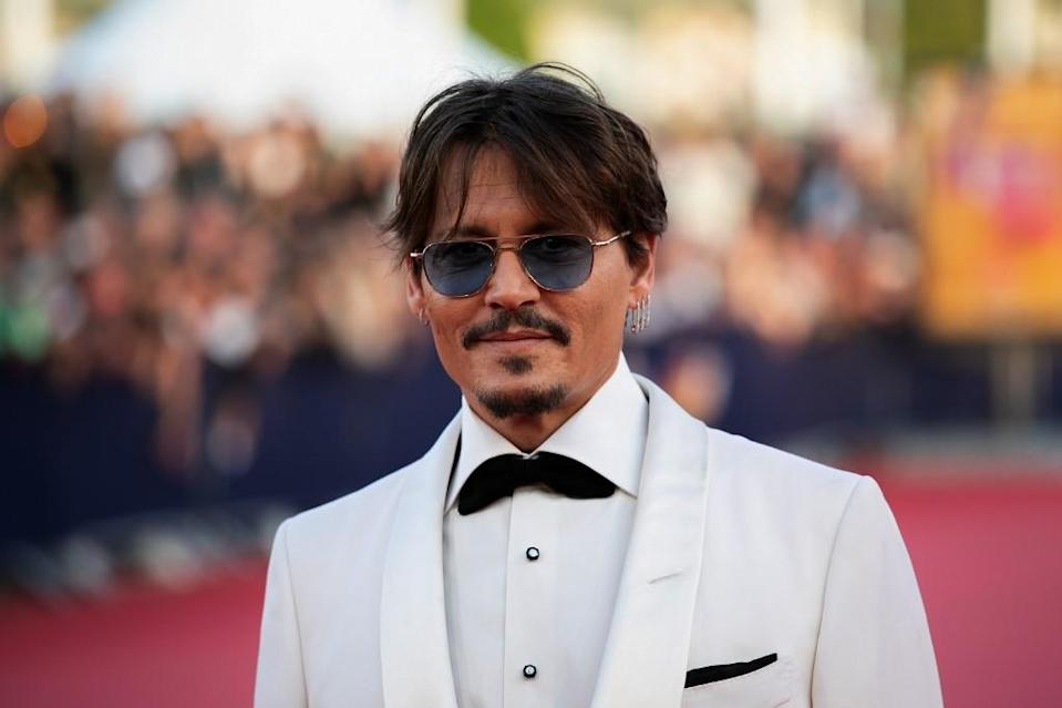 "US actor Johnny Depp poses on the red carpet as he arrives for the screening of the movie ""Waiting for the Barbarians"" at the 45th Deauville US Film Festival, in Deauville, northern France on September 8, 2019."