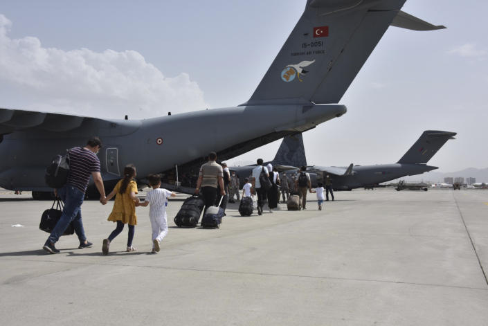 Turkish nationals board a Turkish Air Force plane at Kabul airport, Afghanistan, Wednesday, Aug. 18, 2021. (Turkish Defense Ministry via AP)