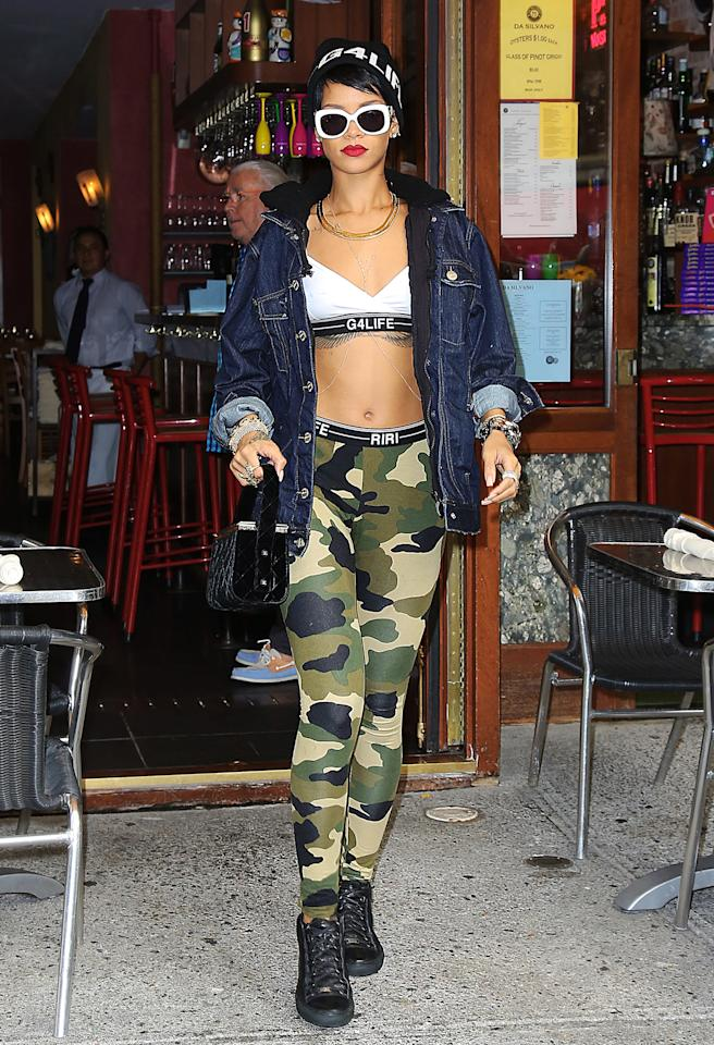 <b>Who:</b> Rihanna<br /><br /><b>Wearing:</b> High-waisted camo leggings and a barely-there top from her own River Island collection<br /><br /><b>Where:</b> Exiting Da Silvano restaurant in NYC
