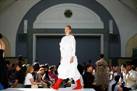 Models present creations during the Molly Goddard catwalk show during London Fashion Week in London