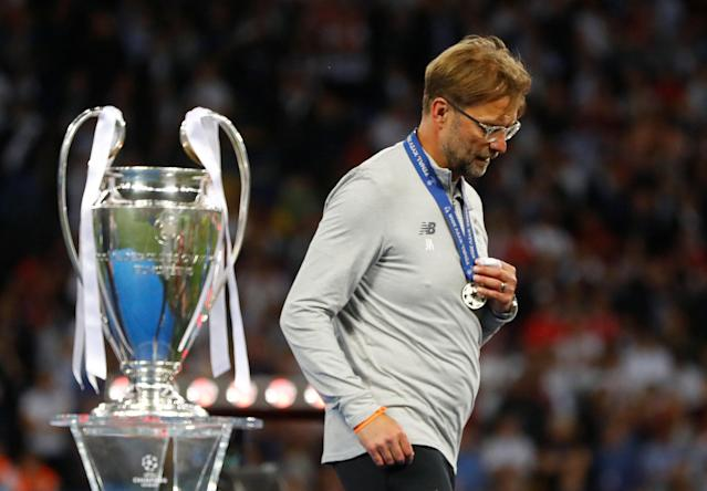 Soccer Football - Champions League Final - Real Madrid v Liverpool - NSC Olympic Stadium, Kiev, Ukraine - May 26, 2018 Liverpool manager Juergen Klopp walks past the trophy with his medal after the match REUTERS/Kai Pfaffenbach