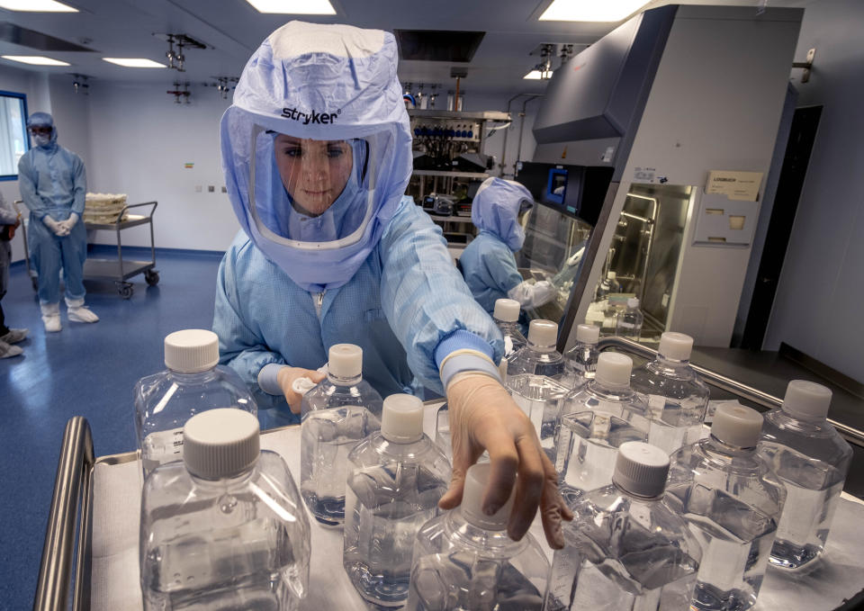 FILE - In this March 27, 2021 file photo a laboratory worker simulates the workflow in a cleanroom of the BioNTech Corona vaccine production in Marburg, Germany, during a media day. Germany's health minister Jens Spahn says today the country has now given a first coronavirus vaccine shot to more than half of its population. (AP Photo/Michael Probst, file)