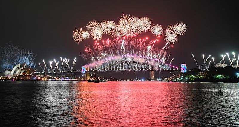 The Sydney Harbour Bridge is bathed in fireworks and lighting effects during New Year's Eve celebrations on January 1, 2019 in Sydney, Australia.