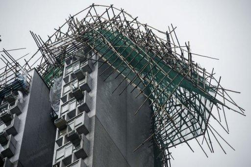 A scaffolding is seen collapsed atop a residential building in the aftermath of Typhoon Vicente in Hong Kong on July 24. Authorities issued a hurricane warning for the first time since 1999 as Typhoon Vicente roared to within 100 kilometres of Hong Kong shortly after midnight