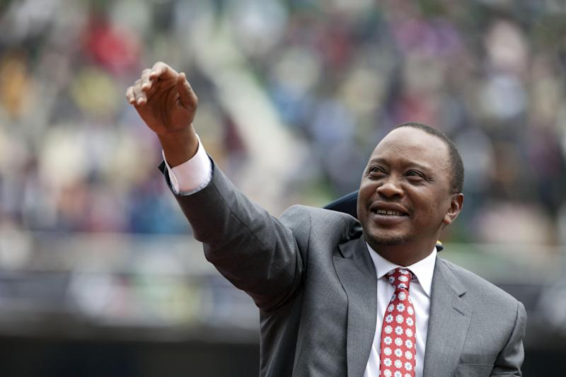 FILE - In this Thursday Dec. 12, 2013 file photo, Kenyan president Uhuru Kenyatta waves to the crowd as Kenya celebrates 50 years of independence in Nairobi, Kenya. Prosecutors at the International Criminal Court have asked judges not to reject their faltering case against Kenyan President Uhuru Kenyatta entirely, despite acknowledging they do not have enough evidence to convict him. Defense lawyers have demanded acquittal. Presiding Judge Kuniko Ozaki said the panel hearing the case in The Hague, Netherlands, will not decide the matter Wednesday Feb. 5, 2014. (AP Photo/Sayyid Azim, File)