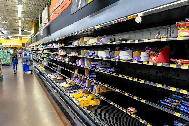 Stores struggle to keep up with demand as shoppers empty shelves March 17 at the Henderson Walmart, stocking up on supplies as the coronavirus pandemic spreads across the nation, forcing restaurants and bars to close.