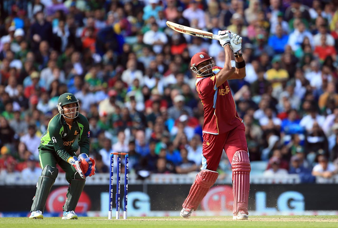 LONDON, ENGLAND - JUNE 07:  Kieron Pollard of West Indies hits a six during the ICC Champions Trophy group B match between West Indies and Pakistan at The Oval on June 7, 2013 in London, England.  (Photo by Richard Heathcote/Getty Images)
