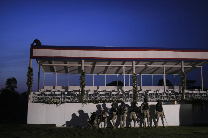 Security forces stand guard before the funeral for slain Haitian President Jovenel Moise at his family home in Cap-Haitien, Haiti, early Friday, July 23, 2021. Moise was assassinated at his home in Port-au-Prince on July 7. (AP Photo/Matias Delacroix)