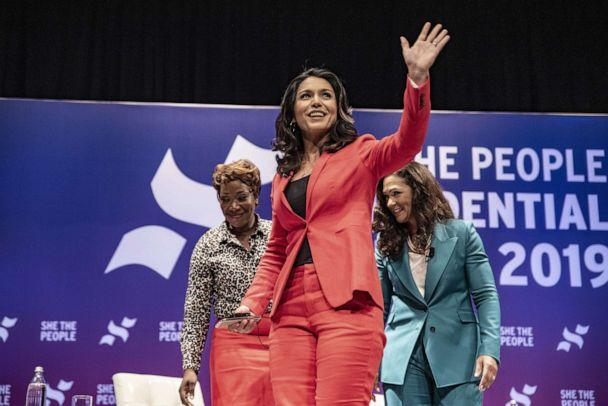 PHOTO: Democratic presidential candidate Rep. Tulsi Gabbard (D-HI) waves to a crowd at the 'She The People Presidential Forum,' April 24, 2019, in Houston, Texas. (Sergio Flores/Getty Images, FILE)