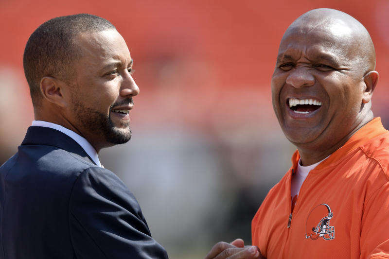 Browns GM Sashi Brown (left) was fired Thursday and the team's owner said Hue Jackson would remain head coach in the 2018 season. (AP)