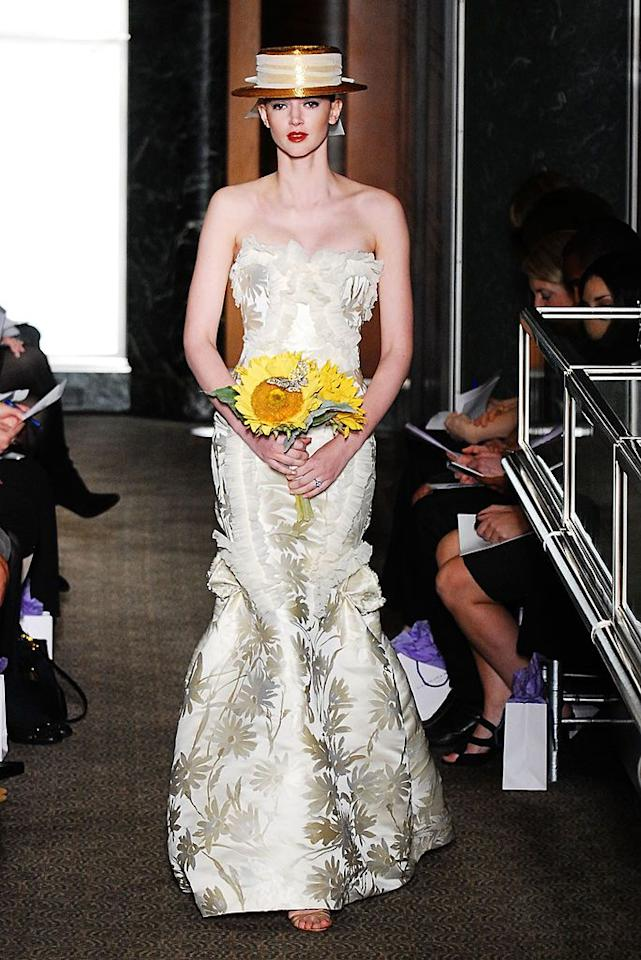 <p>While Van Gogh embraced the full color spectrum in his paintings,  Herrera found inspiration in the artist's work while staying true to the traditional white wedding dress with this look. The floral designs could be seen as inspired by any number of things, but Herrera's choice to include the sunflower bouquet clarify her inspiration behind the gown.</p>