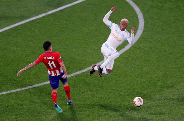 Soccer Football - Europa League Final - Olympique de Marseille vs Atletico Madrid - Groupama Stadium, Lyon, France - May 16, 2018 Marseille's Clinton Njie in action with Atletico Madrid's Angel Correa REUTERS/Vincent Kessler