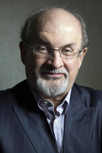 """File-This Sept. 8, 2012 file photo shows author Salman Rushdie posing for a photo as he promotes the movie """"Midnight's Children"""" during the 2012 Toronto International Film Festival in Toronto. Put Rushdie, Martin Amis and Ian McEwan on a stage and expect a night of high art and school boy humor, of reading, writing and Christopher Hitchens. (AP Photo/The Canadian Presss, Chris Young, File)"""