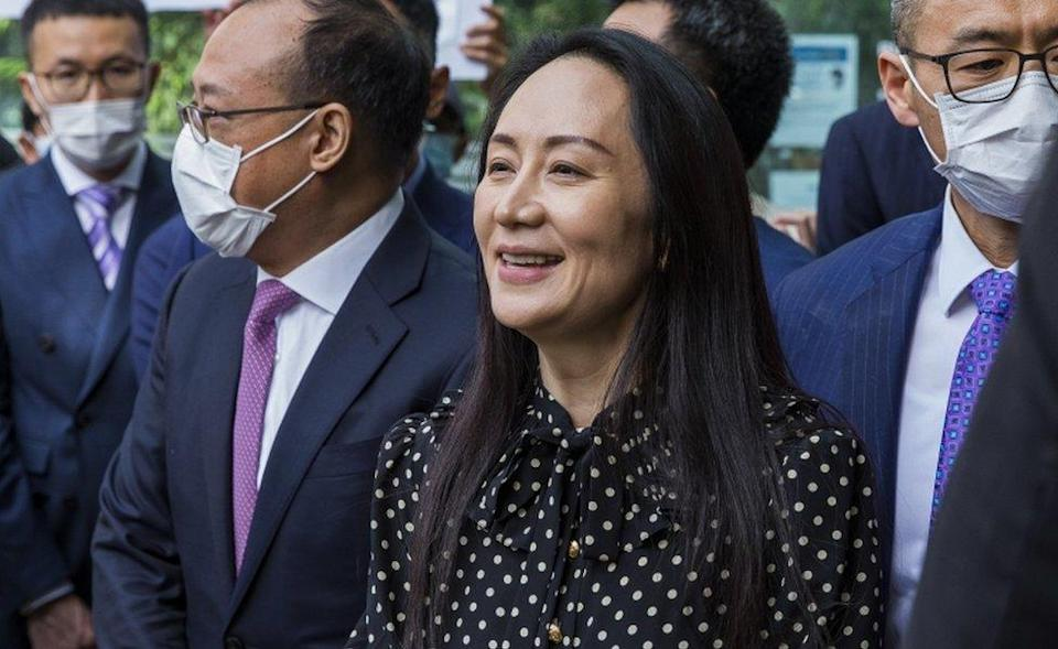 Meng Wanzhou (C) leaves British Columbia Supreme Court and speaks to the media in Vancouver, British Columbia, Canada 24 September 2021.