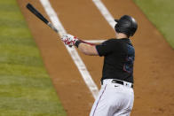 Miami Marlins' Garrett Cooper watches his two-run home run during the fourth inning of the team's baseball game against the Washington Nationals, Saturday, Sept. 19, 2020, in Miami. (AP Photo/Lynne Sladky)