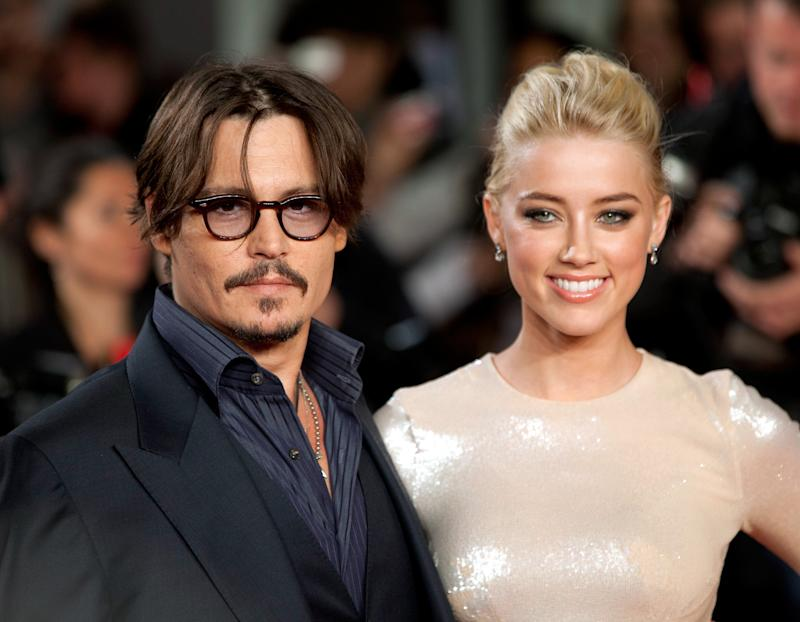 "Johnny Depp and Amber Heard attend the premiere of ""The Rum Diary"" in London when they were still a couple. (John Phillips via Getty Images)"