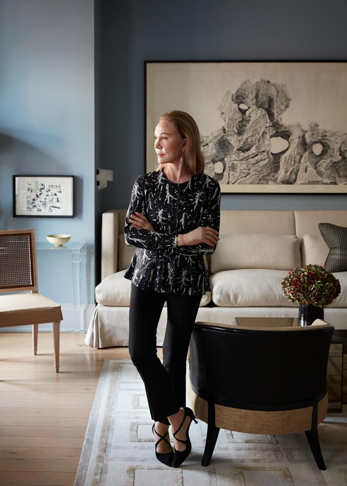Nunnerley stands in the living room of her Upper East Side apartment.