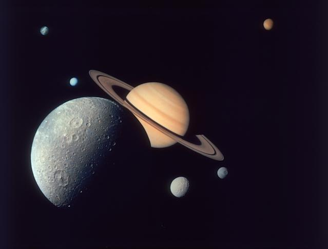 A montage of Saturn and its moons Dione (front), Tethys and Mimas (right), Enceladus and Rhea (left), and Titan (distant top), as depicted by the Voyager 1 spacecraft, November 1980. (Photo by Space Frontiers/Hulton Archive/Getty Images)