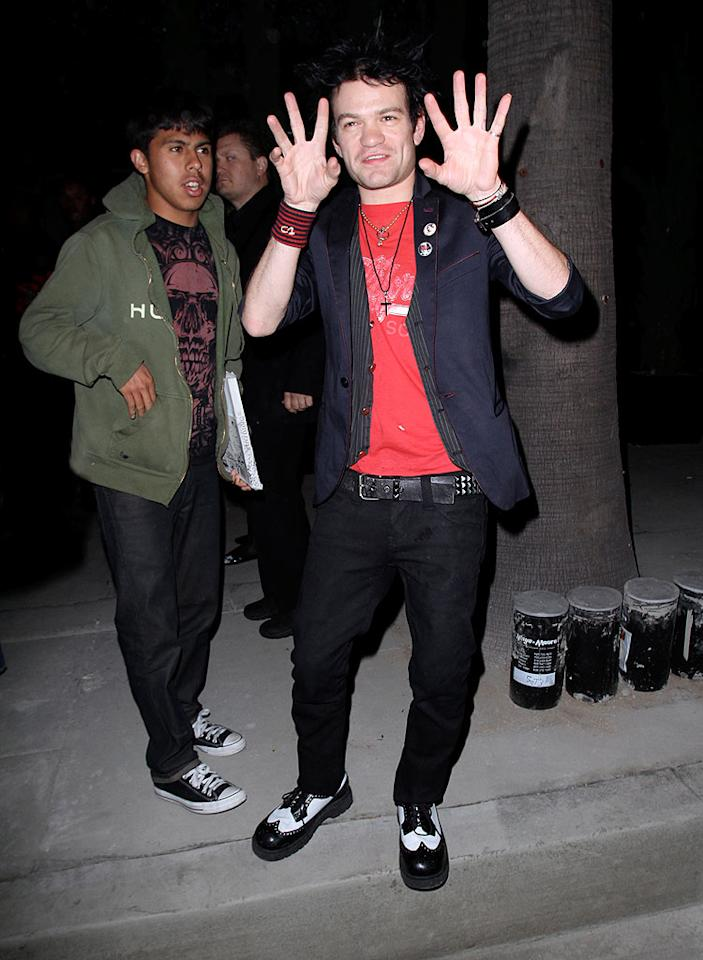 """Sum 41 singer Deryck Whibley did his best impersonation of a mime, but ended up looking more like a scary clown thanks to those black and white kicks. Epa-Maciel-Araujo/<a href=""""http://www.x17online.com"""" target=""""new"""">X17 Online</a> - April 13, 2010"""