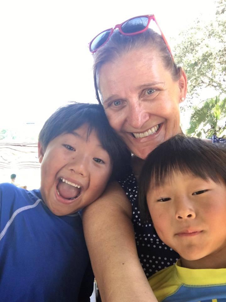Jill Robbins and her two younger sons at a water park.