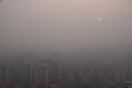 Buildings of a residential compound are seen in the haze during a polluted day in Beijing
