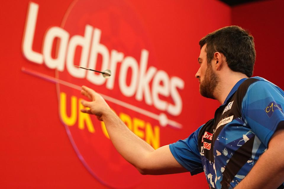 A player throws a dart at the Ladbrokes UK Open (PA Wire)