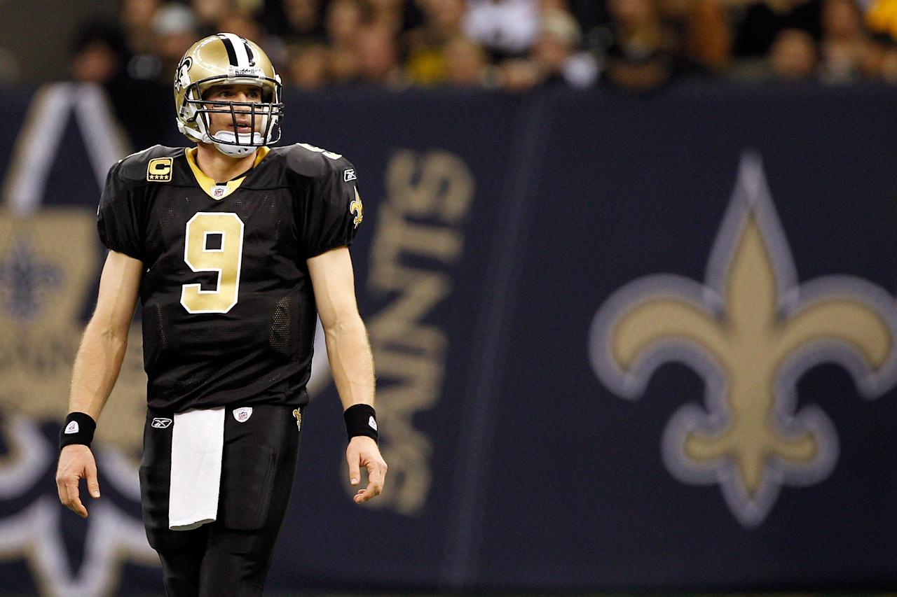 NEW ORLEANS, LA - DECEMBER 26:  Quarterback Drew Brees #9 of the New Orleans Saints looks on in the first half against the Atlanta Falcons at the Mercedes-Benz Superdome on December 26, 2011 in New Orleans, Louisiana.  (Photo by Chris Graythen/Getty Images)