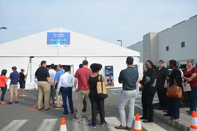 People waited outside a temporary building to get registered for the hiring process. The event started at 8 a.m. but people from New York, New Jersey and Pennsylvania were already in line by 7 a.m. (Krystal Hu/Yahoo Finance)