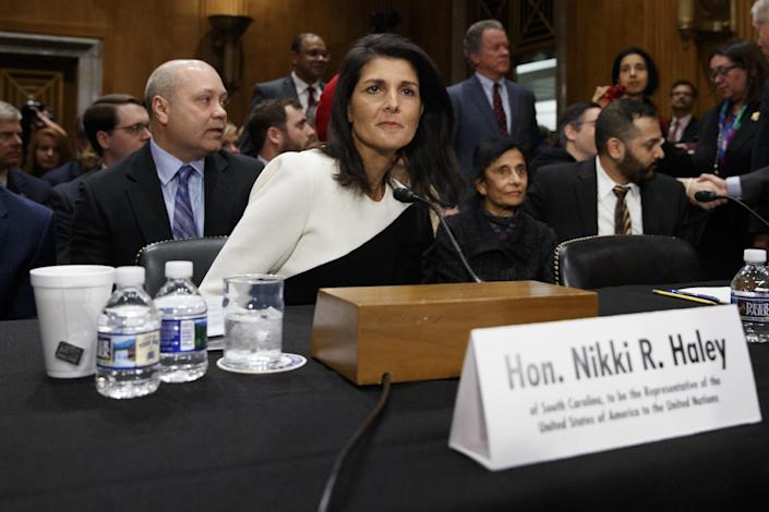 UN Ambassador-designate, South Carolina Gov. Nikki Haley, accompanied by her husband Michael, left, prepares to testify on Capitol Hill in Washington, Wednesday, Jan. 18, 2017, at her confirmation hearing before the Senate Foreign Relations Committee. (AP Photo/Evan Vucci)
