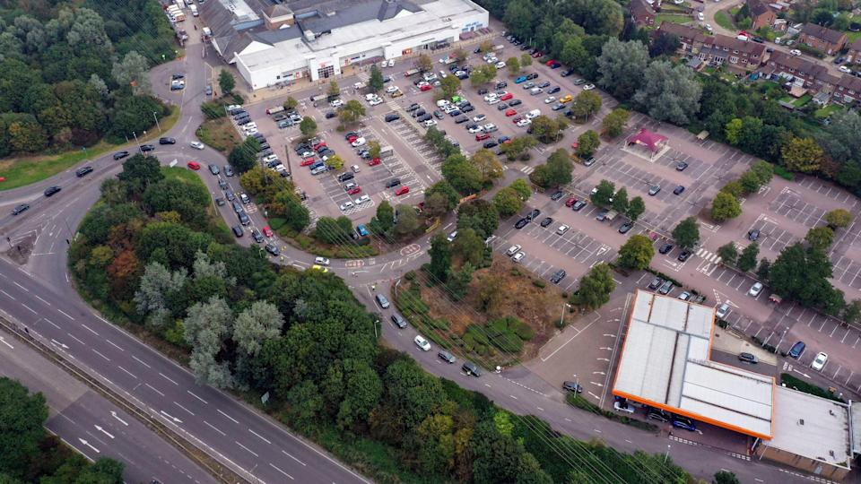 Cars queue for fuel at a Sainsbury's in Camberley, Surrey (PA)