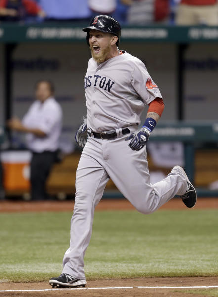 Boston Red Sox's Mike Carp reacts as he heads for home plate after his 10th-inning grand slam off Tampa Bay Rays relief pitcher Roberto Hernandez during a baseball game Wednesday, Sept. 11, 2013, in St. Petersburg, Fla. Mike Napoli, David Ortiz, and Dustin Pedroia all scored on the hit. (AP Photo/Chris O'Meara)
