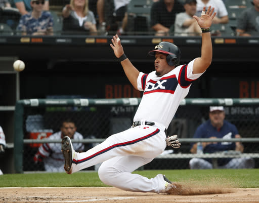Chicago White Sox's Jose Abreu slides in safely scoring a run during the sixth inning of a baseball game against the Minnesota Twins Sunday, June 30, 2019, in Chicago. (AP Photo/Jeff Haynes)