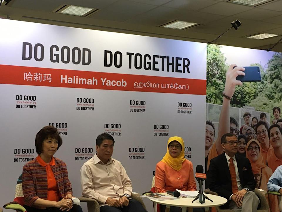 Presidential hopeful Halimah Yacob with members of her campaign team (L-R) NTUC president Mary Liew, former NMP Lawrence Leow and NUS academic Simon Tay. PHOTO: Nicholas Yong