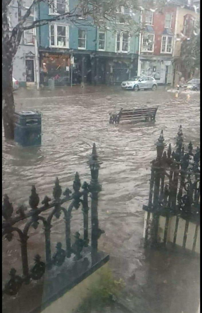 Cars struggle to move through floodwater in Aberystwyth, Wales. (Tom Kendall)