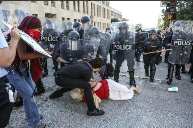 The woman was mowed down by the marching police force. Source: Reuters