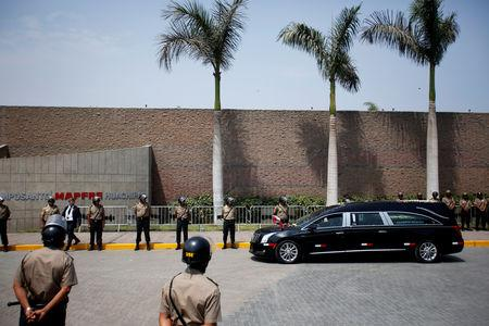 The hearse carrying the remains of Peru's former President Alan Garcia, who killed himself this week, arrives at the Mapfre Cemetery, in Lima, Peru April 19, 2019. REUTERS/Janine Costa