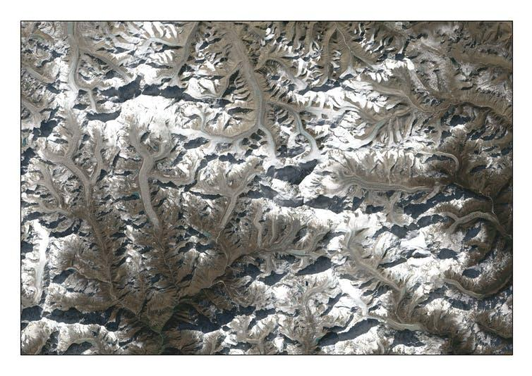 """<span class=""""caption"""">NASA Landsat satellite photograph showing glaciers in the Everest region.</span> <span class=""""attribution""""><a class=""""link rapid-noclick-resp"""" href=""""https://landsat.gsfc.nasa.gov/"""" rel=""""nofollow noopener"""" target=""""_blank"""" data-ylk=""""slk:NASA/Landsat"""">NASA/Landsat</a>, <a class=""""link rapid-noclick-resp"""" href=""""http://creativecommons.org/licenses/by/4.0/"""" rel=""""nofollow noopener"""" target=""""_blank"""" data-ylk=""""slk:CC BY"""">CC BY</a></span>"""