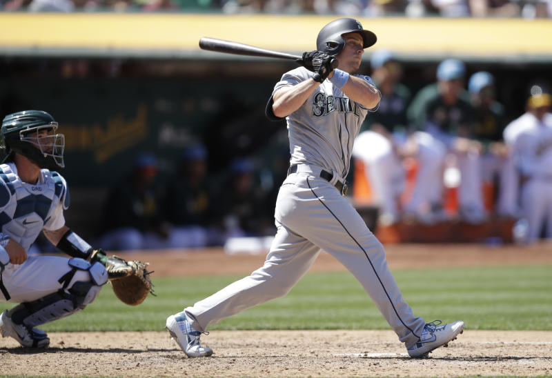 Seattle Mariners' Kyle Seager watches his two-run double hit off Oakland Athletics' Lou Trivino in the eighth inning of a baseball game Sunday, June 16, 2019, in Oakland, Calif. (AP Photo/Ben Margot)