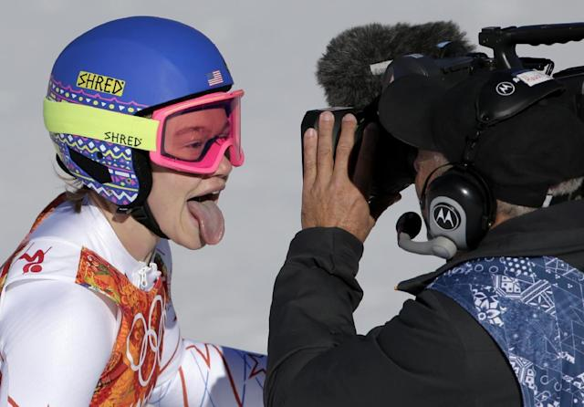 United States' Laurenne Ross sticks her tongue out at a television camera after finishing the women's downhill at the Sochi 2014 Winter Olympics, Wednesday, Feb. 12, 2014, in Krasnaya Polyana, Russia. (AP Photo/Gero Breloer)