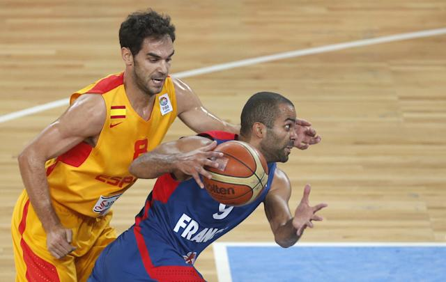 France's Tony Parker, foreground, challenges for the ball with Spain's Jose Calderon during their EuroBasket European Basketball Championship semifinal match in Ljubljana, Slovenia, Friday, Sept. 20, 2013. (AP Photo/Darko Bandic)