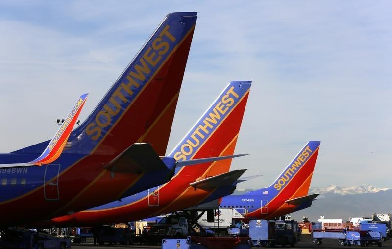 Southwest Airlines jets wait on the tarmac at Denver International Airport in Denver