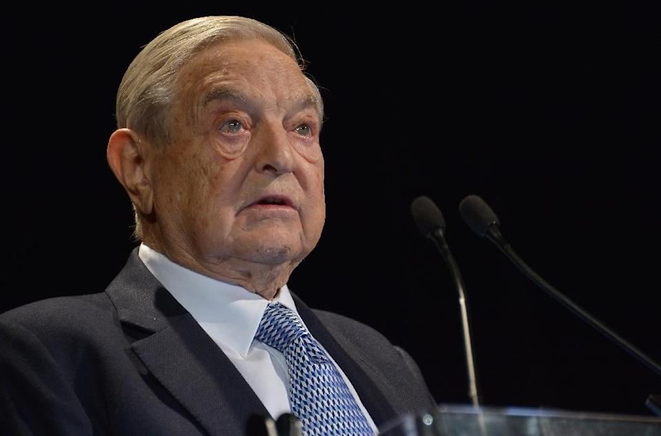 US financier George Soros speaks onstage at the Annual Freedom Award Benefit hosted by the International Rescue Committee at the Waldorf-Astoria hotel in New York City on November 6, 2013 (AFP Photo/Mike Coppola)